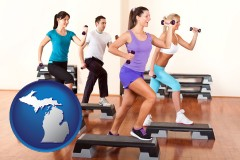 an exercise class at a gym - with MI icon