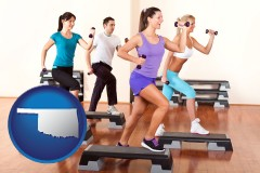an exercise class at a gym - with OK icon